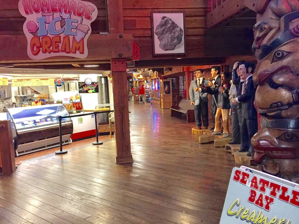 Family visiting Seattle explores the Miners Landing food court.
