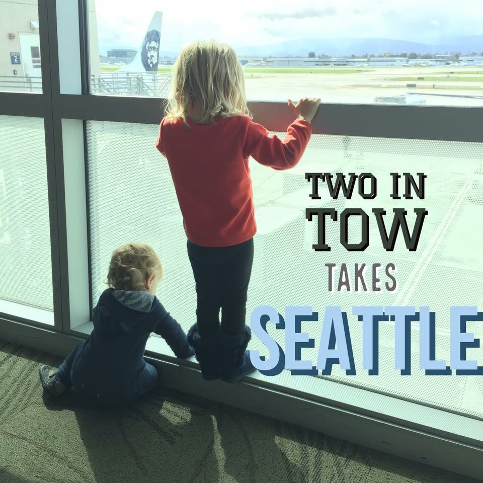 Two children look at airplanes while waiting to board an Alaskan Airlines flight to Seattle.
