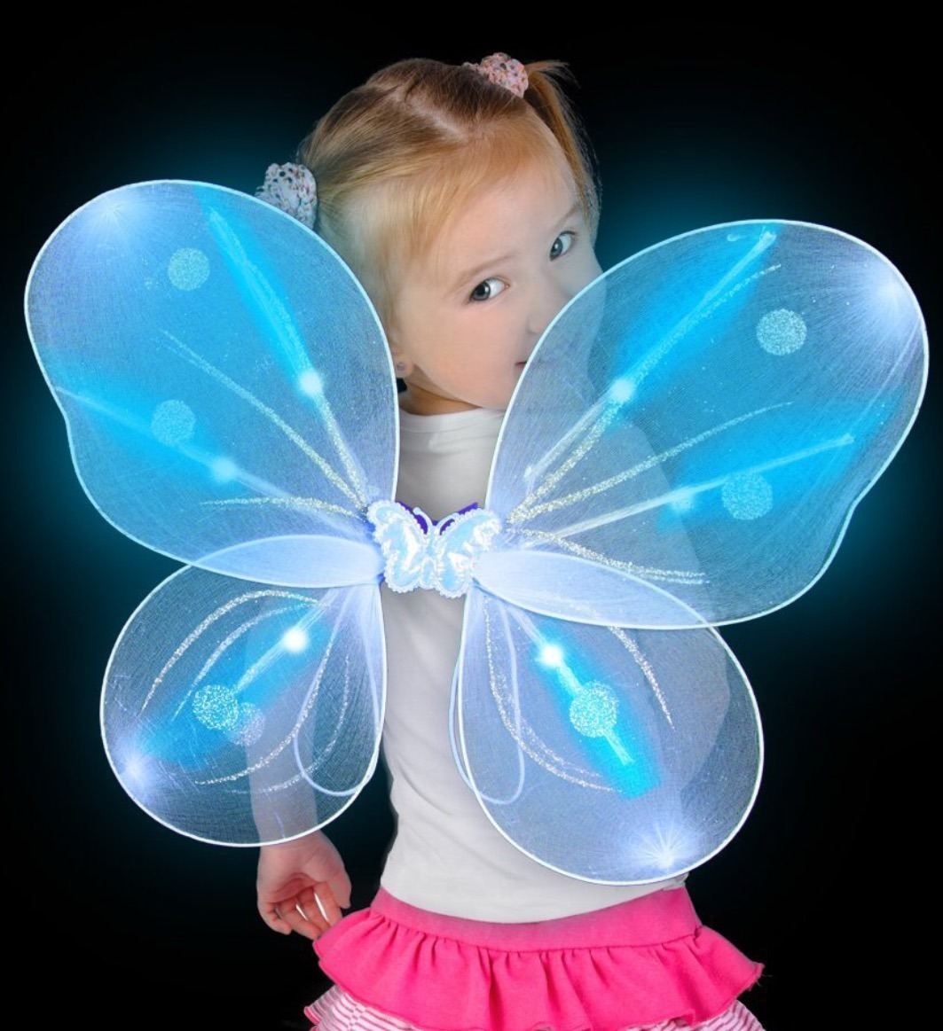 0ab2f4a8bae9 These LED Light-up Wings are shimmery blue with silver glitter and have blue  lights. Put it all together, and magic: Toddler wears butterfly fairy  princess ...