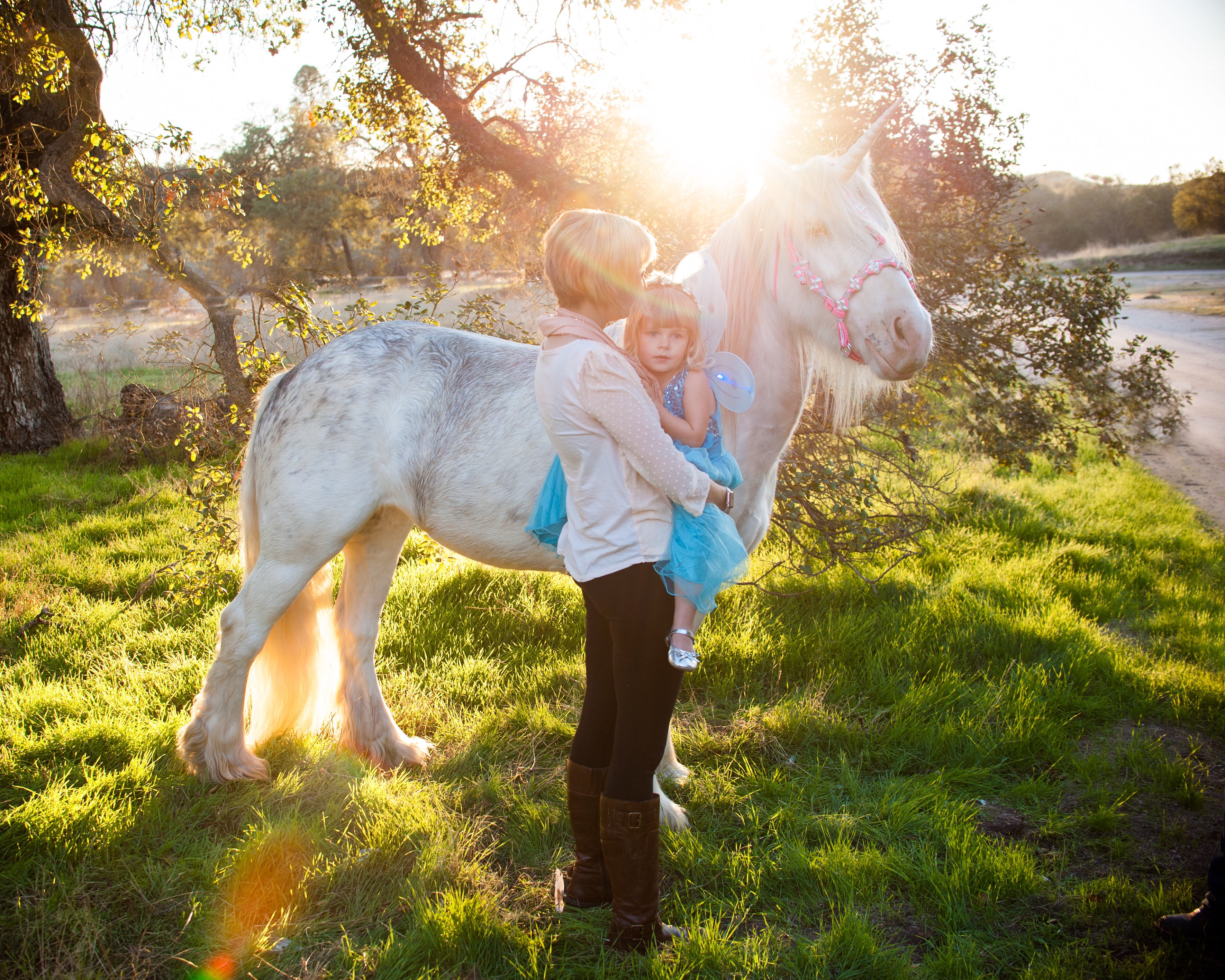 Mother and daughter spend time with magical unicorn in Creston, California.