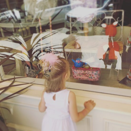 Little girl Window shopping at Bijou in Downtown Paso Robles California