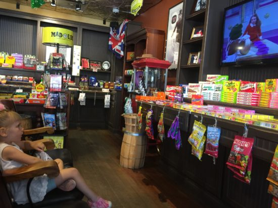 Here is a photo of a 3 year old eating candy at SLO Sweets in Downtown Paso Robles. Things to do with Kids in Downtown Paso Robles.
