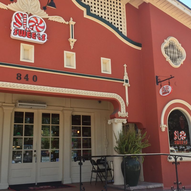 Picture of the SLO Sweets candy store in the historical bathhouse building in downtown Paso Robles