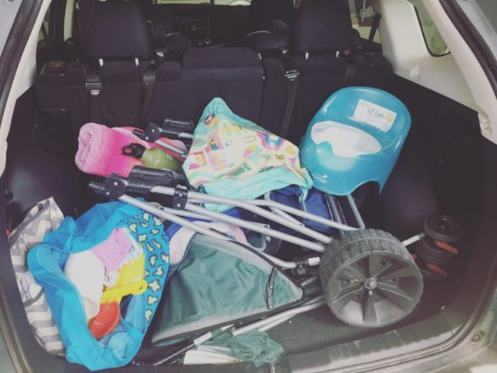 Packing the car for a beach trip with kids