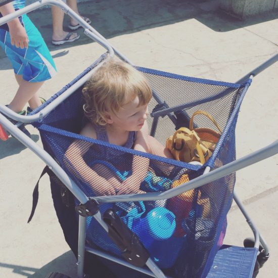Baby in a beach cart
