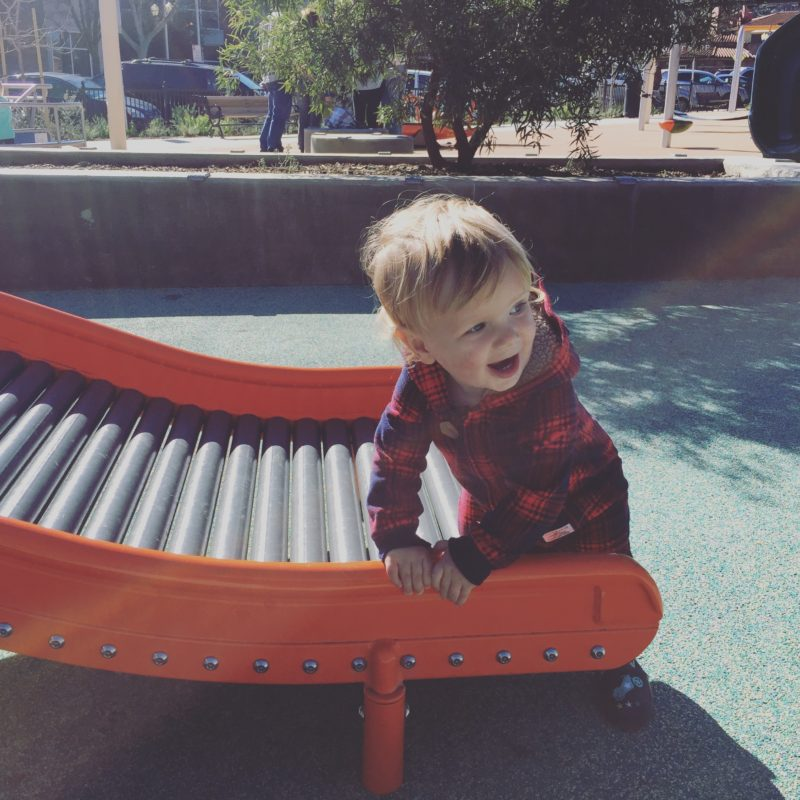 Baby on the roller slide at Paso Robles Downtown City Park playground