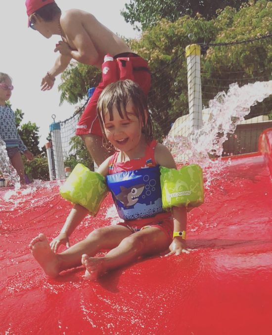 Kid on a waterslide