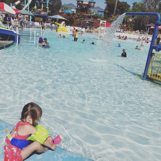 little girl in front of Tadpool at waterpark
