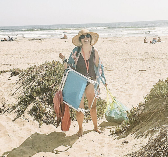 Mom at the beach hauling all her kids toys