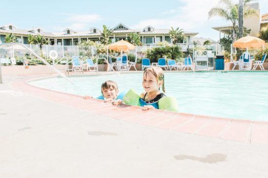 Two kids swimming Review of Avila Lighthouse Suites, Avila Beach