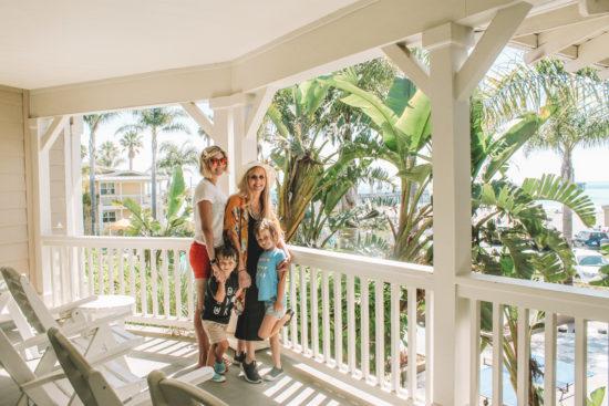 Family posing on balcony at Review of Avila Lighthouse Suites, Avila Beach
