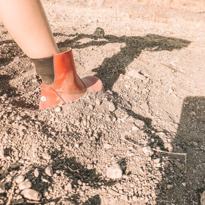 Girl in dusty Bobux Paddington Red Boot