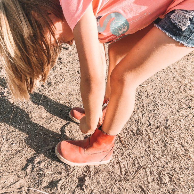 Girl hiking in Bobux Paddington Red Boot