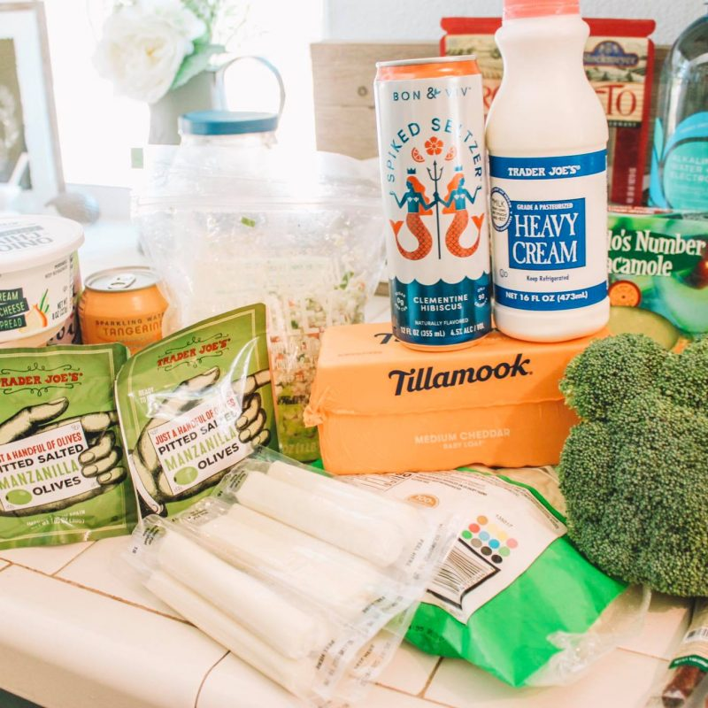 Trader Joe's Keto haul with pictures of groceries like cheese, meat and almond milk