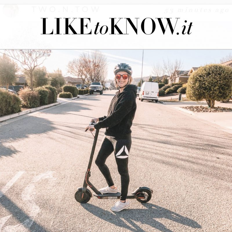 Girl on a scooter telling people to shop leggings and gear