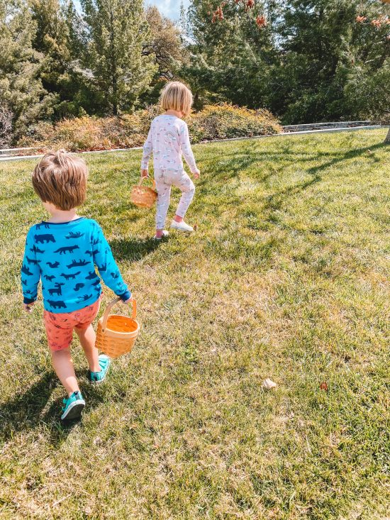 Kids walking on grass with baskets