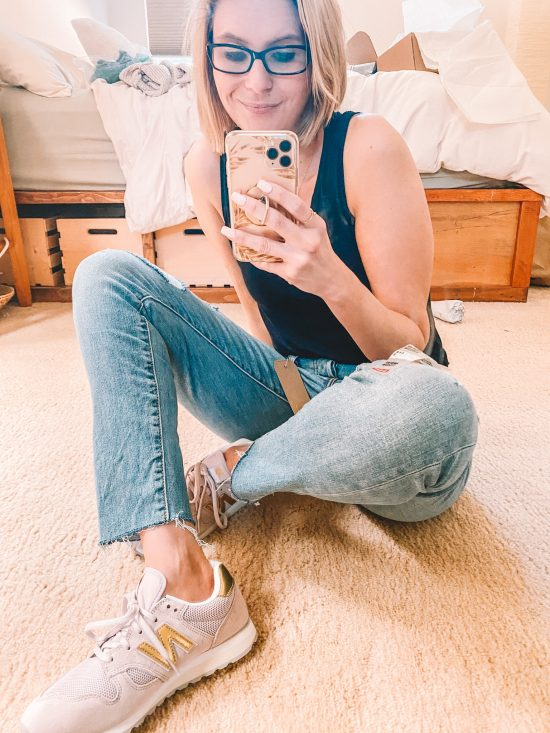 Mom jeans pose