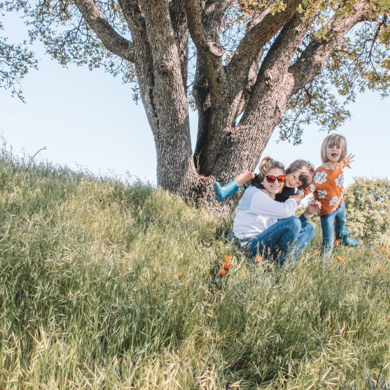 mom, son and daughter under an oak tree