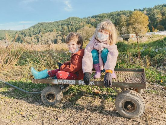 two kids on a wagon