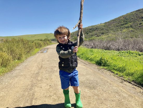 kid with giant hiking stick