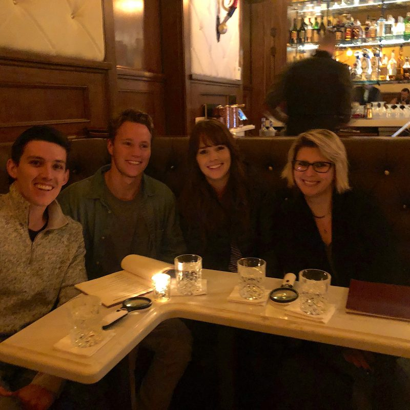 group in dimly lit bar