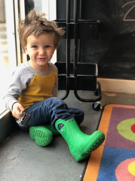 boy in green boots