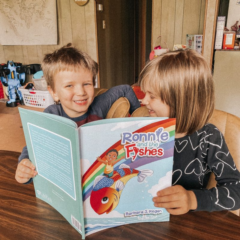 KIDS WITH BOOK SMILING