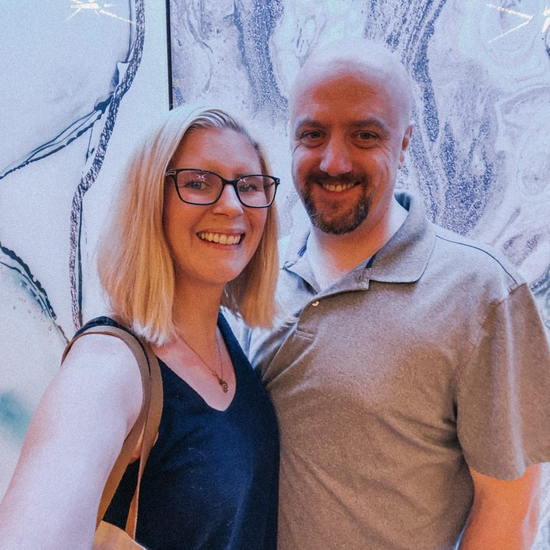 couple standing in front of blue light wall at Copper & Salt Northwest Kitchen